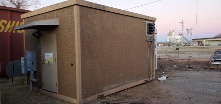 Used 12' x 16' Fibrebond Concrete Shelter 1
