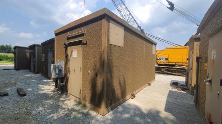 Used 12x20 Fibrebond Concrete Shelter 1